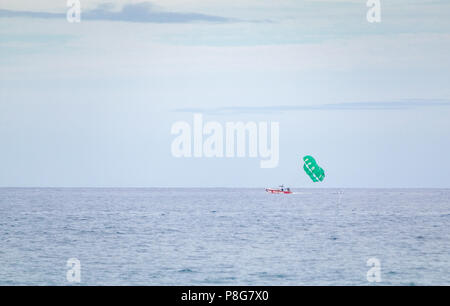 UFO Parasail boat near Maui with passengers preparing for parasailing - Stock Image
