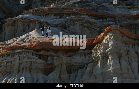 Hikers on Cliffs and sandstone, tilted rock layers Red Rock Canyon State Park California Mojave Desert - Stock Image