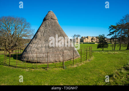 The 16th century Ice House used for storing imported ice before the invention of refrigeration Holkham Hall Norfolk UK - Stock Image