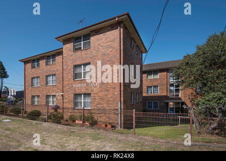 An early Sydney 3 level apartment, home-unit block named Banksia. Built in Austere style with double brick and timber it is simple with no balconies. - Stock Image