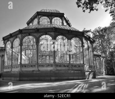 A monochrome picture of the Palacio de Cristal (Crystal Palace) in the Buen Retiro Park area of Madrid, Spain. This iron framework structure was completed in 1887, and is a must visit location. © CH. - Stock Image