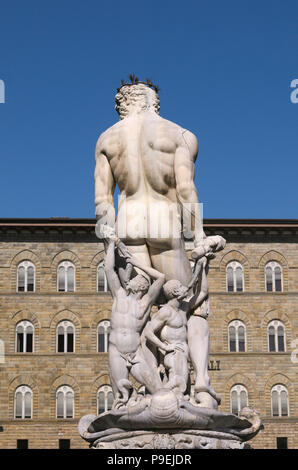 rear view of Neptune statue as part of the fountain on Piazza della Signoria in Florence, Italy - Stock Image