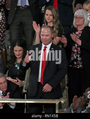 February 5, 2019 - Washington, District of Columbia, U.S. - Elvin Hernandez, a Special Agent with the Trafficking in Persons Unit of the Department of Homeland Security's Homeland Security Investigations division, acknowledges the audience's applause after being introduced by United States President Donald J. Trump during his second annual State of the Union Address to a joint session of the US Congress in the US Capitol in Washington, DC on Tuesday, February 5, 2019. Pictured behind Mr. Hernandez, from left to right, are: Heather Armstrong, Madison Armstrong and Debra Bissell (Credit Imag - Stock Image