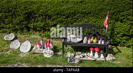 Quirky garden ornaments for sale in a village, Denmark. - Stock Image