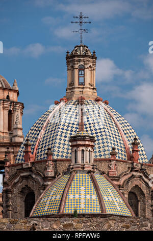 The tiled domes of the San Francisco Convent and the Aranzazu Chapel in the Plaza de Aranzazu in the state capital of San Luis Potosi, Mexico. The chapel and convent was built between 1749 and 1760 and features Churrigueresque details and tiled domes. - Stock Image
