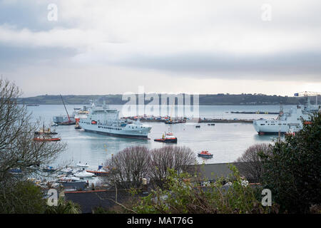 Falmouth Docks, Cornwall, UK. 4th April, 2018. Royal Fleet Auxillary Tide-class replenishment tanker, RFA Tidesurge, being manouevered into postion at A & P at Falmouth Docks Cornwall by tug boats as it is final fitted with sensitive military equipment prior to UK sea trials and entry into service later in 2018., . Credit: Mick Buston/Alamy Live News - Stock Image