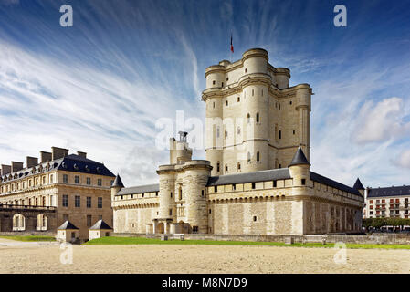 Chateau de Vincennes in Paris. France castle with French national flag under the sunny blue sky. - Stock Image