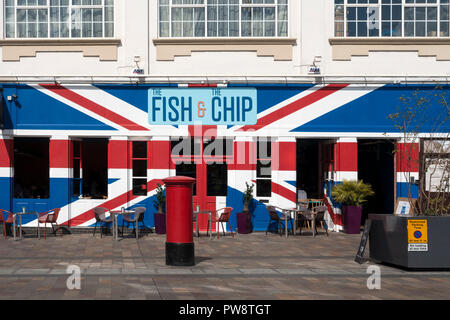 Exterior of 'The Fish and The Chip' restaurant painted with colourful red, white and blue Union Jack Flag, Jubilee Square, Leicester, England, UK - Stock Image