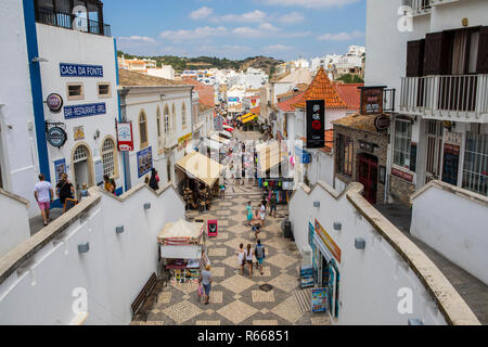 ALBUFEIRA, PORTUGAL - JULY 13TH 2018: A view looking down the pedestrianised Rua 5 de Outubro in the old town area of Albufeira in Portugal, on 13th J - Stock Image