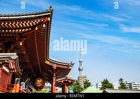 Tokyo, Japan. Large red lantern at the Senso-Ji Temple with the Tokyo Sky Tree communications tower in the background in the Asakusa neighborhood - Stock Image