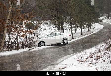 automobile on icy winding country road - Stock Image