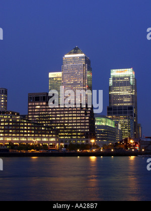 Canary Wharf and surrounding office buildings Docklands London England at night - Stock Image