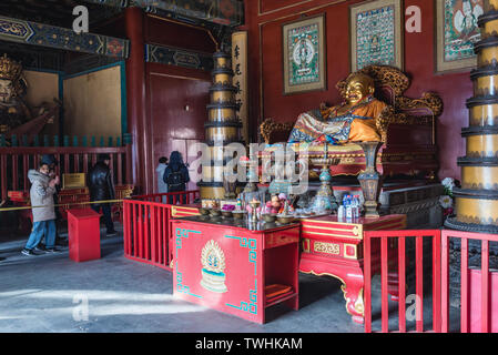Laughing Buddha in Gate Hall of Harmony and Peace Yonghe Temple also called Lama Temple of the Gelug school of Tibetan Buddhism in Beijing, China - Stock Image