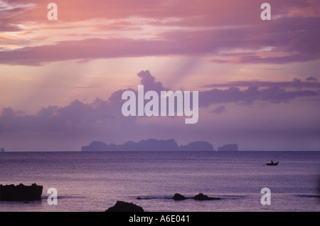 Fisherman and Koh Pi Pi islands shot from Koh Lanta Thailand - Stock Image