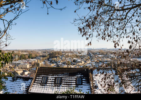 A view from a footpath above Tory across a sunny snowy Bradford on Avon and Wiltshire countryside - Stock Image
