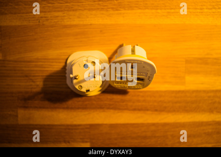 A pair of two UK to EU adapters. - Stock Image