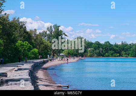 People and families with multi-racial backgrounds enjoying summer in sand beach and blue water in Rouge National - Stock Image