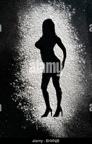 image of silhouette of naked woman made of cocaine - Stock Image