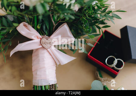 Wedding bouquet tied with pink ribbon - Stock Image