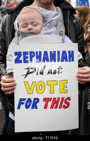 Baby asleep at People's Vote March, London, England - Stock Image
