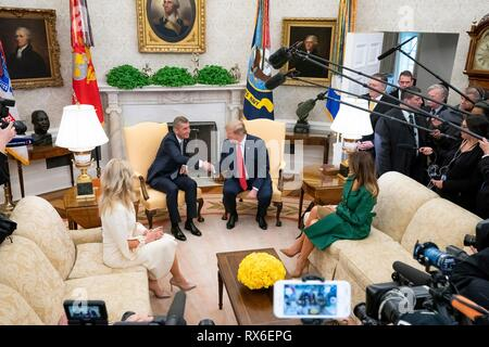 U.S President Donald Trump, First Lady Melania Trump sit together with Czech Prime Minister Andrej Babis and his wife Monika Babisova before a bilateral meeting in the Oval Office of the White House March 7, 2019 in Washington, DC. - Stock Image