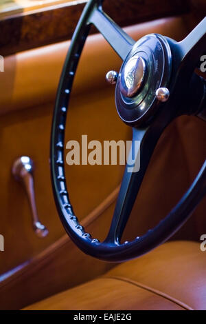 Closeup on vintage car steering wheel, interior retro oldtimer - Stock Image