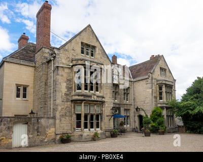 The Deanery Hotel and Restaurant, a Grade II red star listed building dating back to 1625 and located beside Ripon Cathedral North Yorkshire - Stock Image