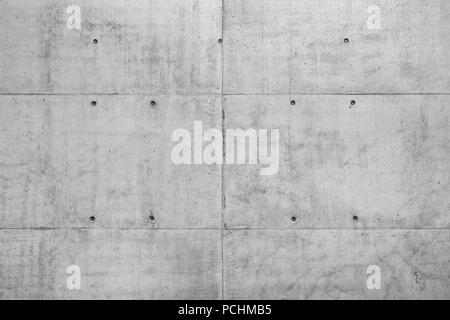 Raw gray concrete wall of a new building as full frame background. - Stock Image