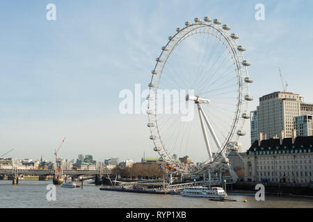 The London Eye tourist attraction on the banks of the River Thames, London, England, UK - Stock Image