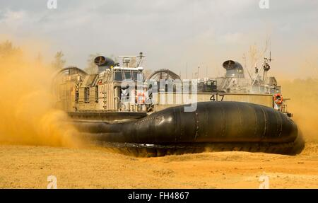 Landing Craft Air Cushioned 47 prepares to deflate on Kin Blue Beach, Okinawa, Japan, Feb. 22. The LCAC was participating - Stock Image
