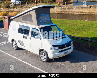 A White Volkswagen Wolfsburg Edition motor caravan with the roof up, parked at the seaside in North Yorkshire - Stock Image