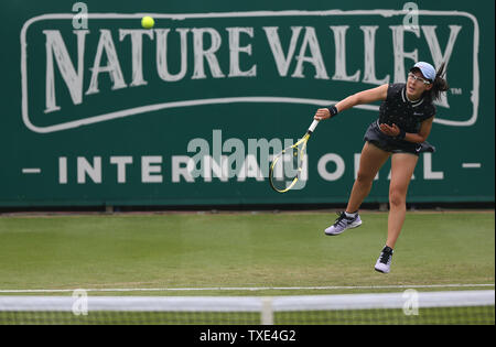 Eastbourne, UK. 24 June 2019 China's Zheng Saisai serves to Marketa Vondrousova of the Czech Republic on Day three of the Nature Valley International at Devonshire Park. Credit: James Boardman / Alamy Live News - Stock Image