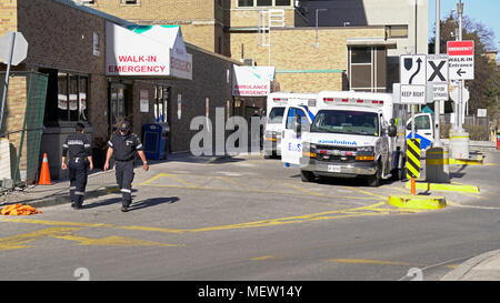 Toronto, Canada. 23rd Apr, 2018. Victims of Alek Minassian van attack in Toronto North York are receiving treatments at Sunnybrook Hospital Emergency, paramedics and ambulances can be seen busy outside the Emergency Entrance of Toronto Sunnybook Hospital Trauma Centre in the afternoon of April 23, 2018 Credit: CharlineXia/Alamy Live News - Stock Image