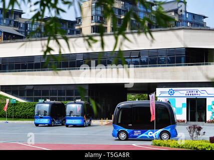 Fuzhou, China's Fujian Province. 24th Apr, 2019. Self-driving buses are seen in the Feifeng Moutain smart park in Fuzhou, capital of southeast China's Fujian Province, April 24, 2019. The Feifeng Mountain smart park, the first AI park of Fujian province, opened in Fuzhou recently. Credit: Wei Peiquan/Xinhua/Alamy Live News - Stock Image
