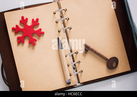 Vintage Notebook of leather cover with antique key - Stock Image