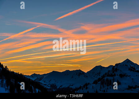 Red skies at sunset over the mountains in Obertauern, Austria - Stock Image