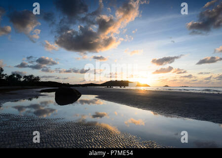 Atmospheric sunrise at Chilli Beach, Cape York Peninsula, Far North Queensland, FNQ, QLD, Australia - Stock Image