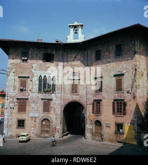 1960s, view from this time of the Plazzo dell'Orologio in the Plazza dei Cavalieri, Pisa, Tuscany, Italy, an ancient medieval building dating back to the 14th century.  Originally a house and tower, they were connected in c1605 by a building which carries a clock and an archway. - Stock Image