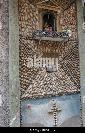 Italy. Sicily, Palermo religious shrine on a wall decorated with oyster and seashells - Stock Image