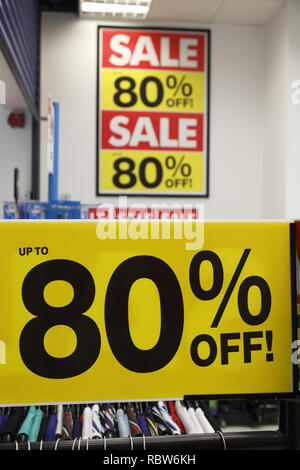 up to 80% sale off sign in a clothing store in the UK - Stock Image