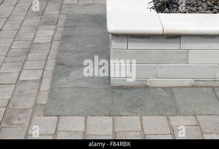 Paved garden detail shot of raised bed a neutral and popular low maintenance landscaping feature for any outdoor - Stock Image