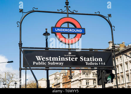 The London Underground sign for Westminster Station in London, England. - Stock Image