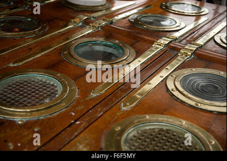brass portholes and access doors on the deck of RRS Discovery Royal Research Ship moored at Discovery Point Dundee - Stock Image
