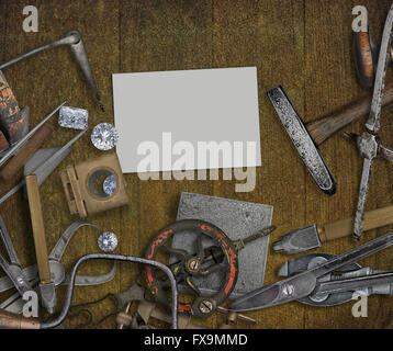 vintage jeweler tools and diamonds over wooden bench, space for text on business card - Stock Image