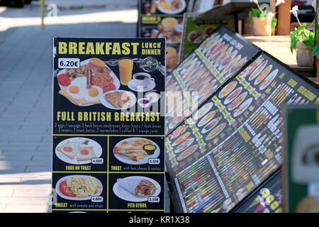 A roadside cafe in Rhodes, Greece temps English tourists by displaying a sign outside for traditional full English - Stock Image