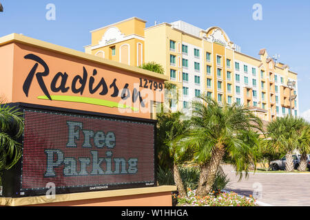 Orlando Florida Buena Vista Radisson Hotel lodging family suites hospitality industry global company exterior message sign LED d - Stock Image