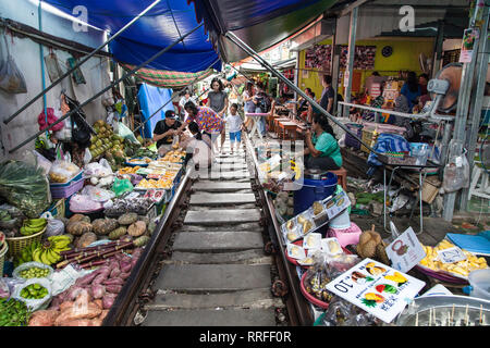 Maeklong, Thailand - August 29, 2018: Market on the Train Tracks in Maeklong, Thailand. With a train passing right through the market, it is one of th - Stock Image
