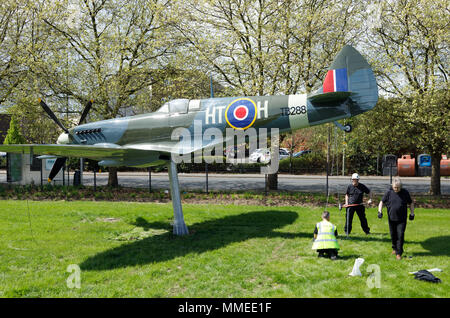 Installing team setting up an overhauled Supermarine Spitfire fighter at the Royal Air Force Museum at Hendon, UK - Stock Image