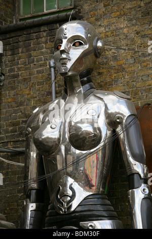 Large Statue of a Female Cyborg Outside Cyberdog Shop in Camden Market, London, UK - Stock Image