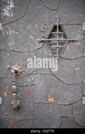 Medieval steel door with handle and viewfinder - Stock Image